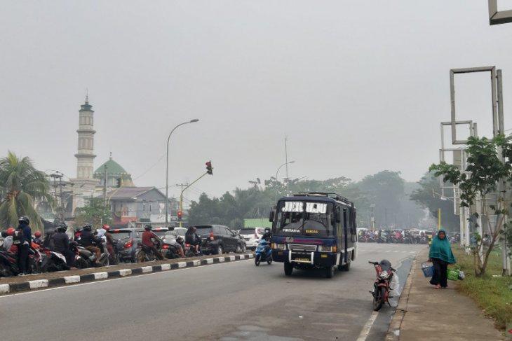 Kota Pontianak masih diselimuti kabut tebal