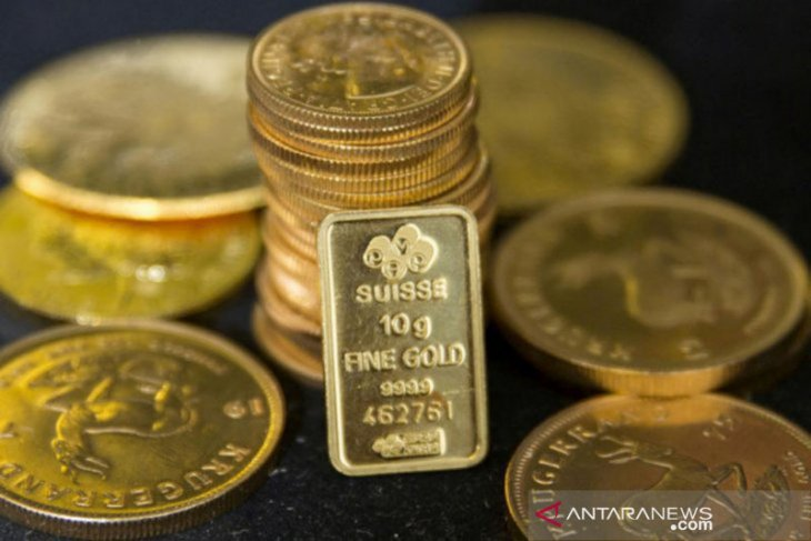 Emas turun 11,8 dolar, ketika negara-negara bersiap  cabut penguncian