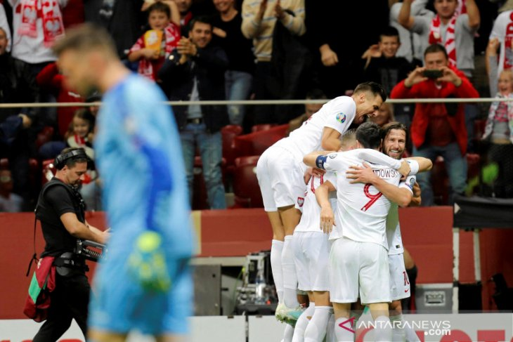 Kualifikasi Piala Eropa, Hasil Grup G: Polandia lolos, empat tim lain berebut satu tiket lagi