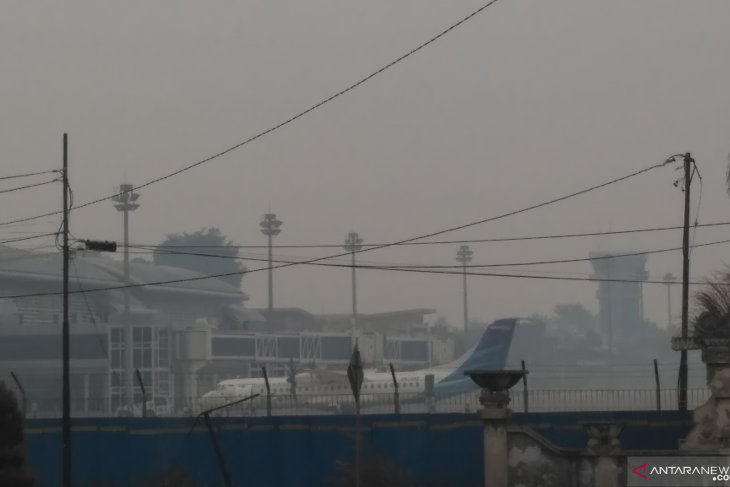 Forest fire-induced haze compels two planes to return to base