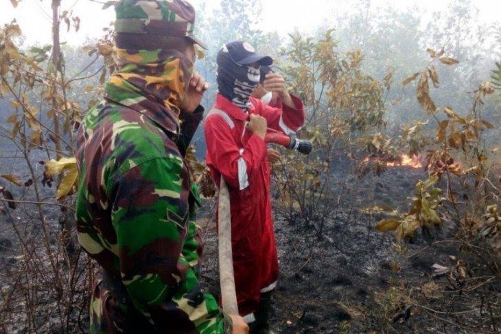 Tim Satgas TNI Kodim 0403 OKU padamkan karhutla