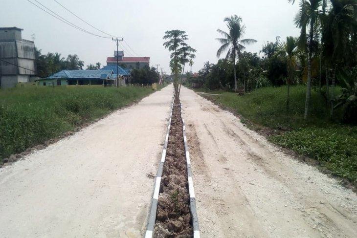 Ruas Jalan Dua Jalur Desa Sanglar Sudah Selesai Ditimbun