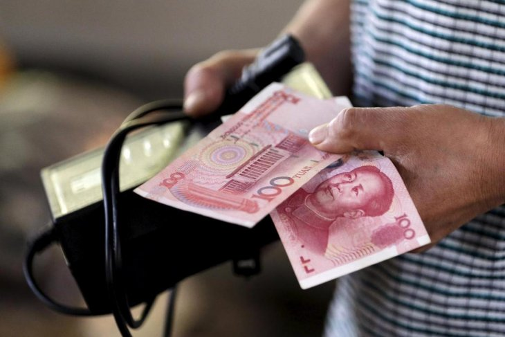 Yuan menguat, naik 19 basis poin jadi 6,5592 terhadap dolar AS