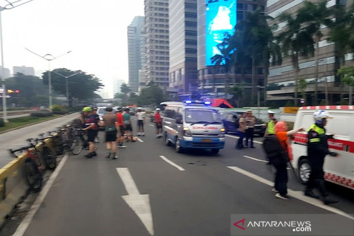 A van driver under drug influence hits seven bicyclists in Jakarta