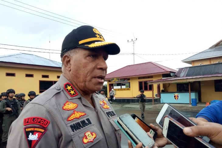 Papua police chief warns his men against arms trafficking