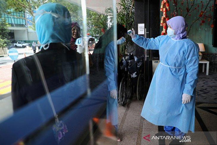 Angka kematian virus corona capai 564 orang, Malaysia perketat perbatasan