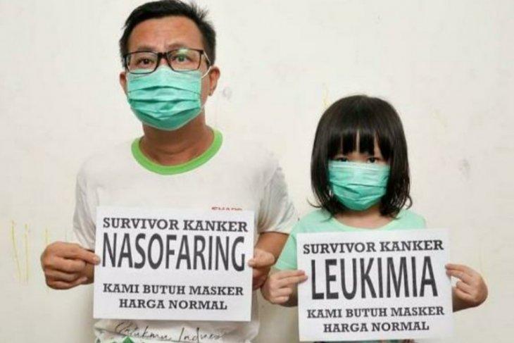Ayah dan anak penyintas kanker resah akibat harga masker