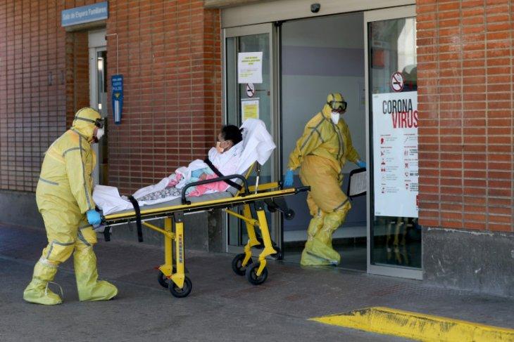 Kasus virus corona di Spanyol lampaui 100.000