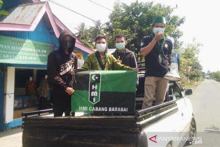 HMI Cabang Barabai keliling desa sosialiasi cegah Corona