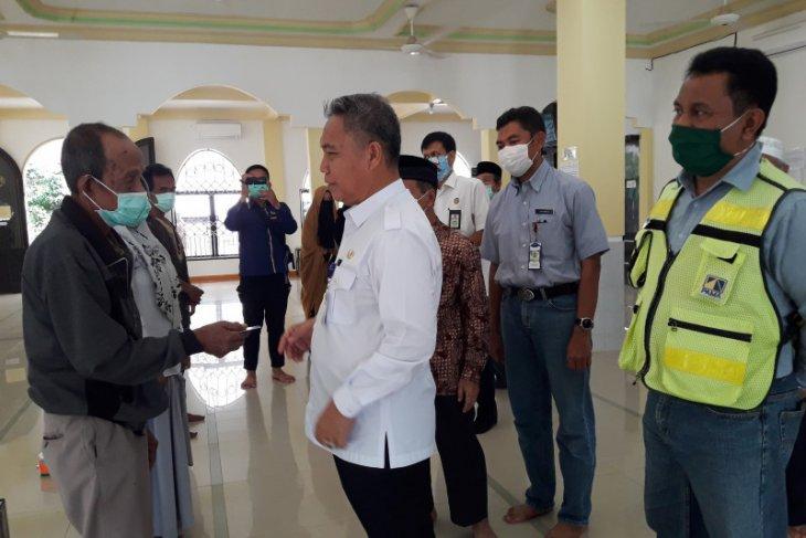 Takmir Masjid - Pama bantu kaum dhuafa lewat ATM beras