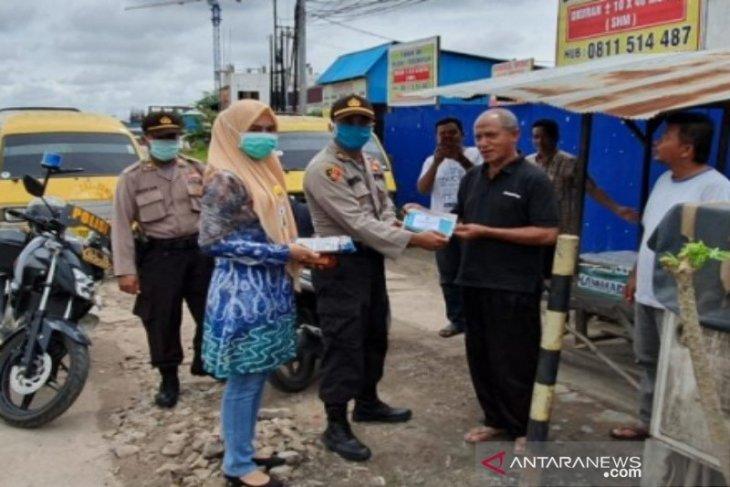 Polsek Banjarmasin Utara imbau warga pakai masker saat di luar rumah