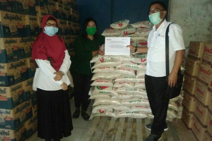Pelindo I- Polda Sumut kerja sama bagikan sembako untuk masyarakat