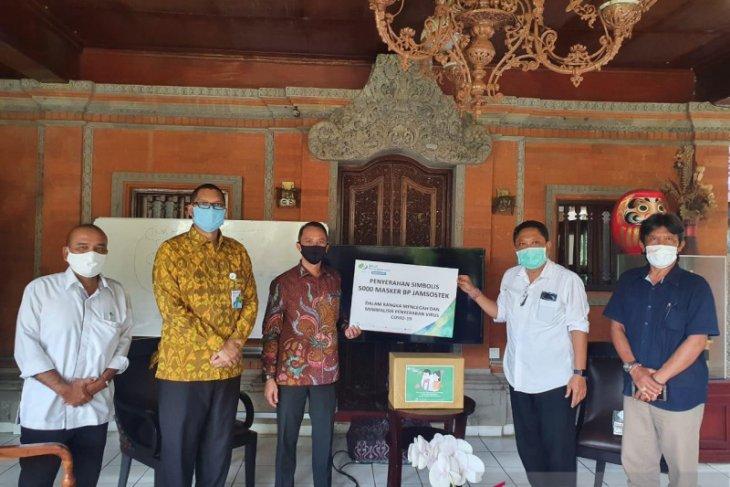 BPJAMSOSTEK bantu 5.000 masker dukung PKM di Kota Denpasar