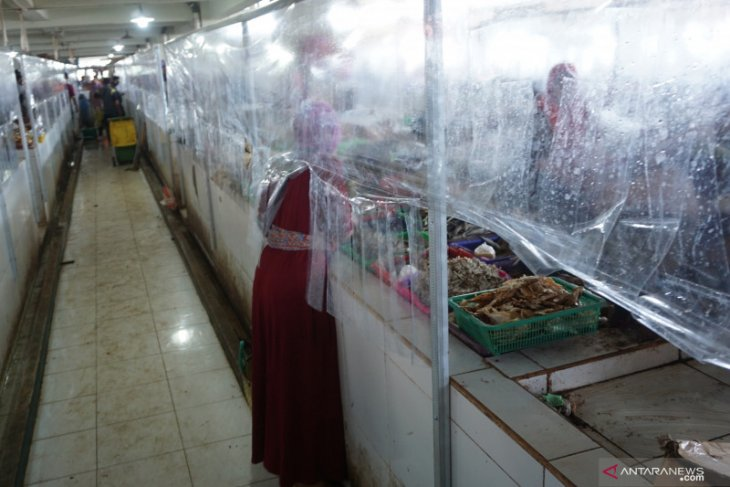 Implementing health protocols in wet markets remains challenging