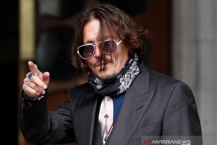 Johnny Depp murka saat  tato