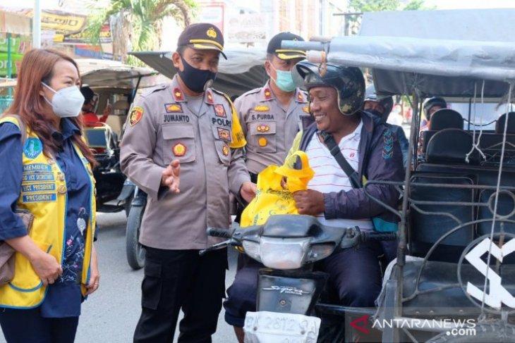 Sinergitas LCM-Polres Tanjungbalai, ratusan pengandara dapat bahan pangan dan panganan siap saji