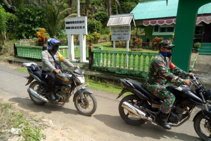 Bhabinkamtibmas Desa Beringin Rayo ikut sukseskan program TMMD 108