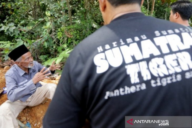 A handler deployed to repel tigers from a village in South Aceh