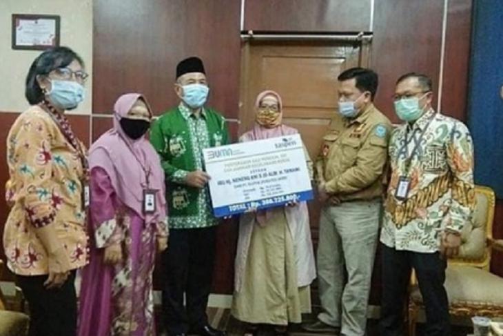 Plt Bupati Merangin serahkan santunan Taspen untuk keluarga H Tamami