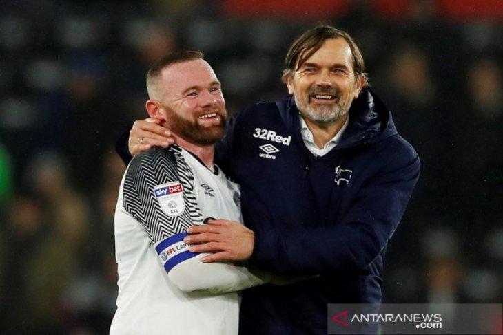 Wayne Rooney jadi pelatih interim Derby setelah Phillip Cocu dipecat