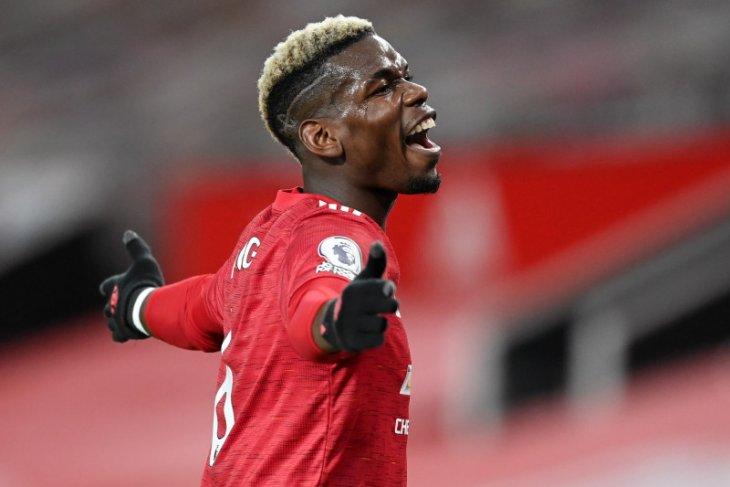 Agen pastikan Paul Pogba tetap bersama  Manchester United