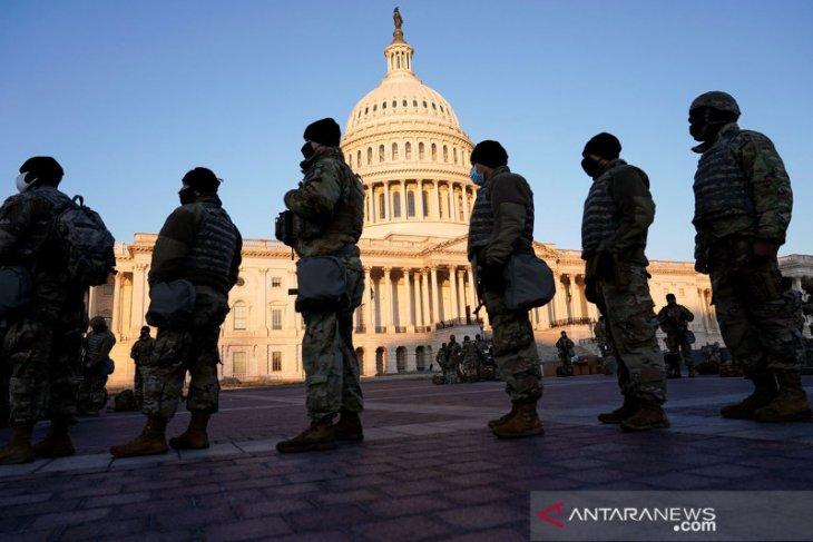 Garda Nasional berjaga 24 jam di Capitol setelah pengepungan