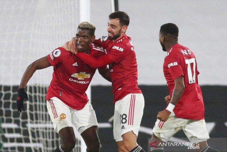 Paul Pogba antarkan Manchester United ke puncak klasemen