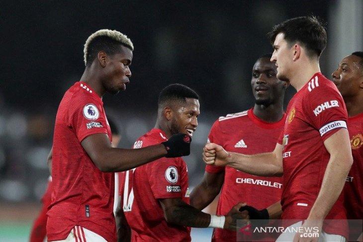 Duo Manchester bertengger di papan atas klasemen Liga Inggris
