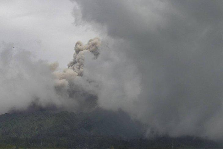 Mount Merapi spews hot clouds rising two kilometers above crater
