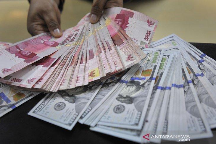 Rupiah menguat sentuh level psikologis Rp14.000 per dolar