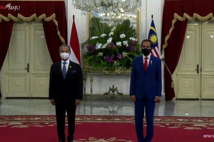 Presiden menjamu PM Malaysia Muhyiddin santap siang rendang