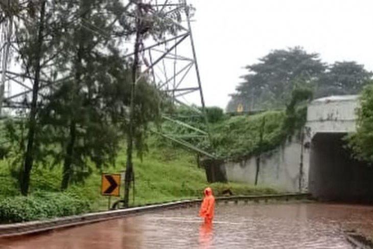 Jakarta Metropolitan Police redirect traffic in Jakarta amid flooding