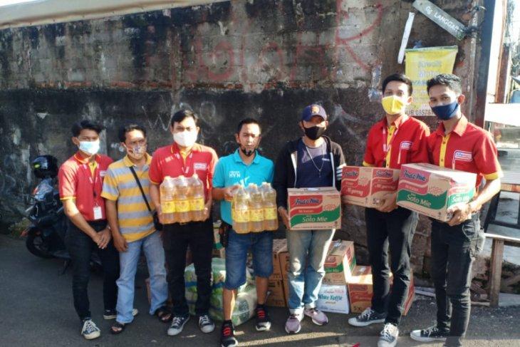 Alfamart berikan bantuan peristiwa banjir di berbagai daerah