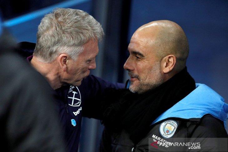 Manajer City  Pep Guardiola ingin punya karier sepanjang David Moyes