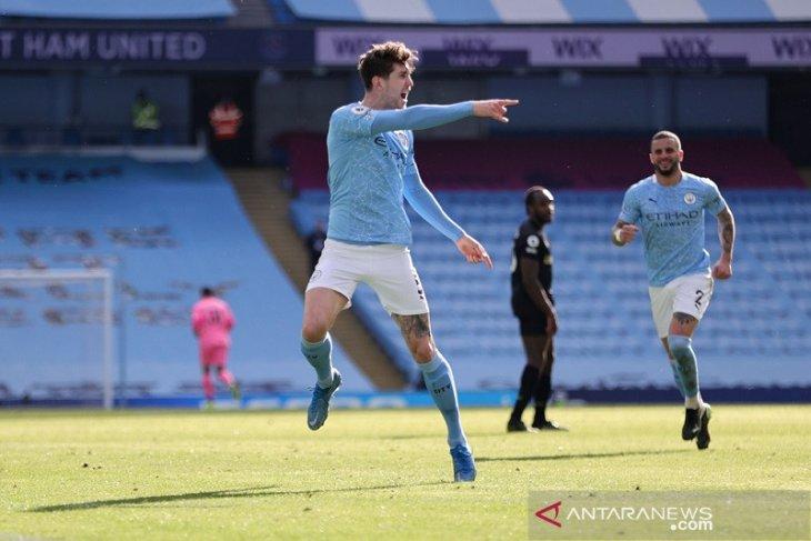 Manchester City kini unggul 12 poin di puncak klasemen Liga Inggris