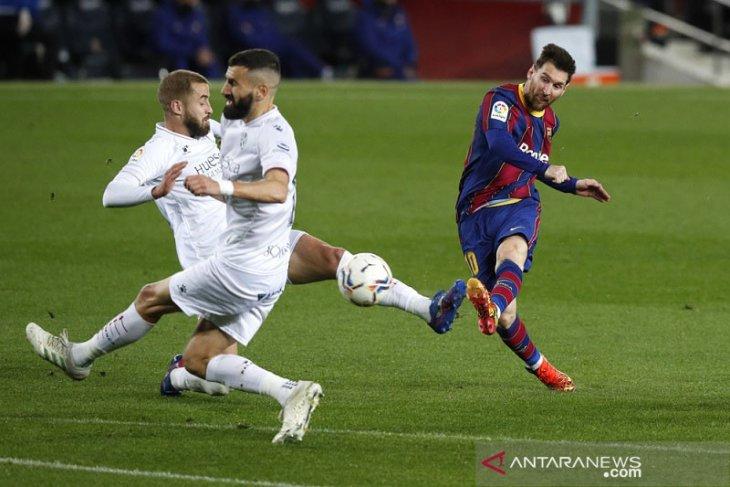 Barcelona geser Real Madrid dari posisi kedua setelah gasak Huesca