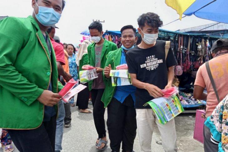 Mahasiswa KKN STAI JM Tanjung Pura Langkat bagikan masker gratis