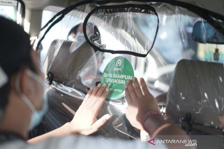 Mitra Driver Gojek di Bali ikuti vaksinasi bersama anggota TNI-Polri