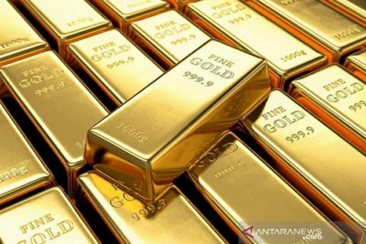 Emas berbalik jatuh 15,8 dolar, terseret