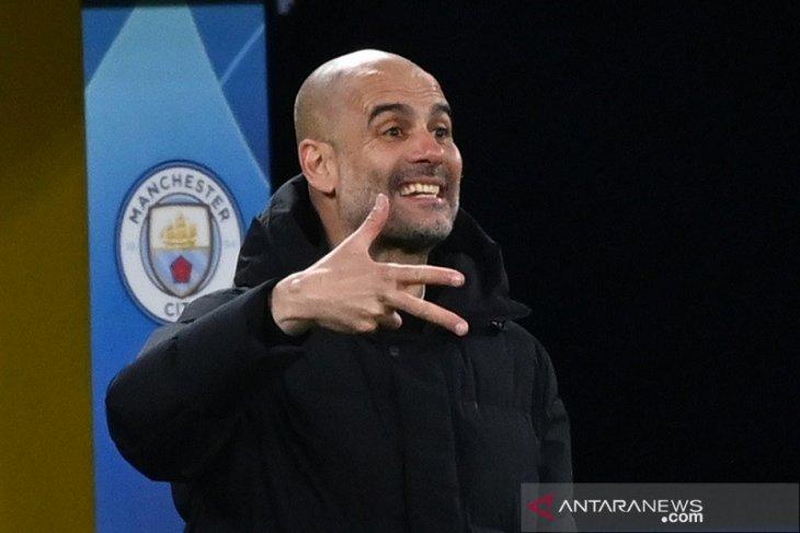 Guardiola mengajak para pemain Manchester City menikmati tekanan saat lawan PSG