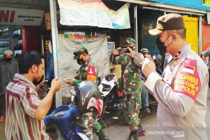 Tiga Pilar Banteng gelar patroli pasar tegakan prokes cegah COVID-19 di Banjarmasin