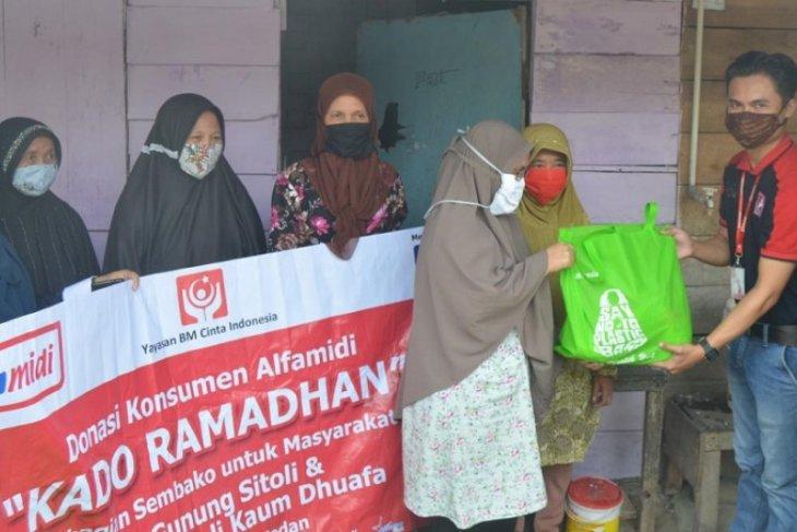 Alfamidi bagikan paket sembako Kado Ramadhan di Nias