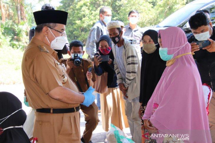 112 KK terdampak banjir di Karang Paci Kalumpang terima bantuan beras