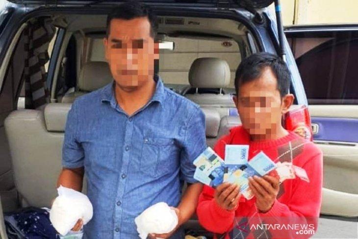 Edar uang palsu, Polisi tangkap dua pelaku