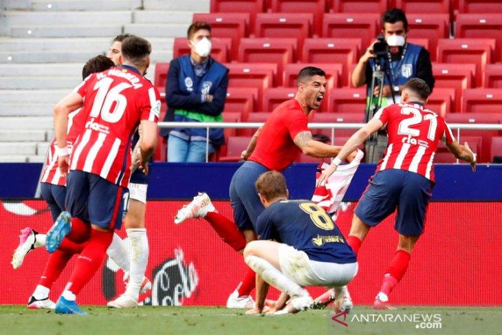 Menang dramatis atas Osasuna, Atletico Madrid bertahan puncaki klasemen liga