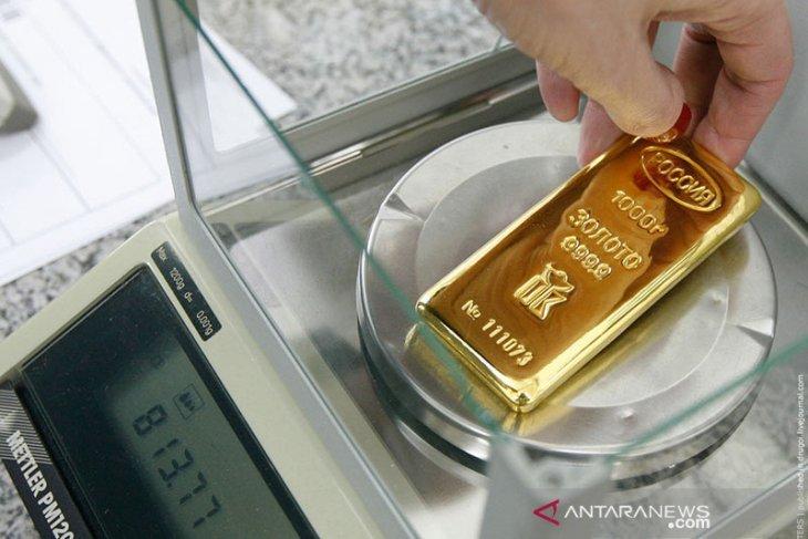 Emas naik ditopang pelemahan dolar yang berlanjutnya risiko Evergrande