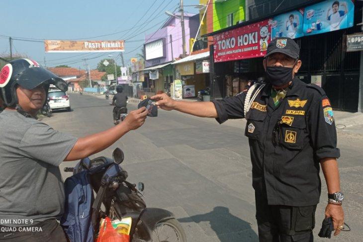 FKPPI Lebak bagikan masker pada warga guna kendalikan COVID-19