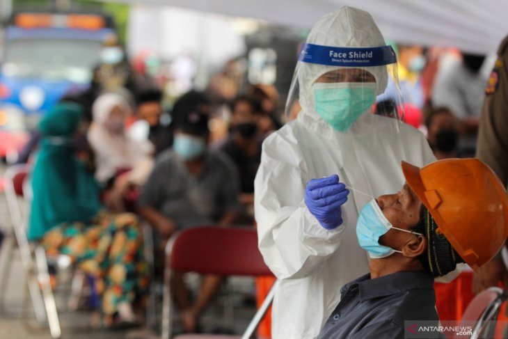Indonesia adds 21,095 COVID-19 cases in single day