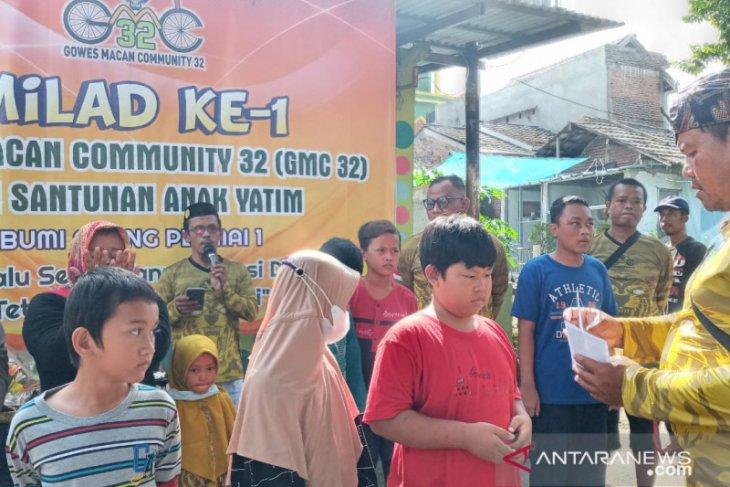 Milad ke-1 komunitas goes GMC32 santuni anak yatim