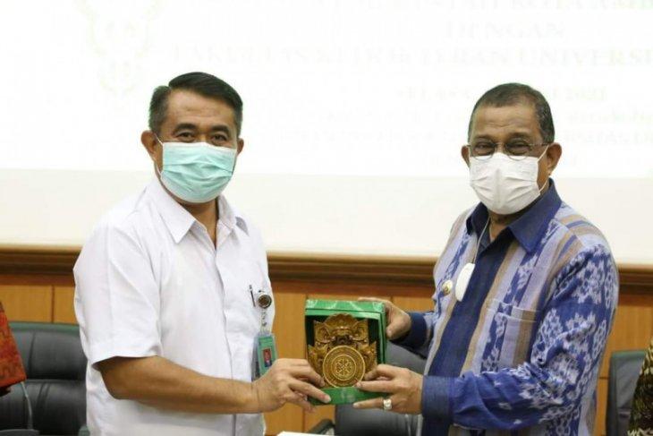 Diapresiasi Pemkot Ambon -  Universitas Udayana kerja sama layanan kesehatan
